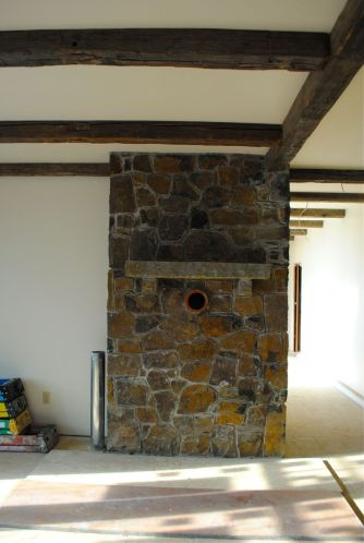 The stone hearth and old beams in living room; you can see beams in the hall ceiling too.