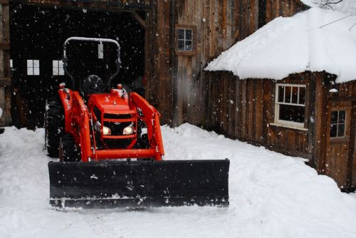 Big Red, after the Christmas Day luncheon with Libby, is ready to clear the farm road of snow.