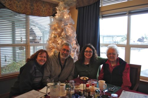 Sher, Bruce, and Teal (my stepdaughter) with Libby on Christmas Day at The Springs Assisted Living facility in The Dalles, Oregon. A lovely holiday meal is served for residents and guests.